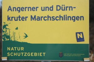 The board indicating the protected natural area Angerner und Dürnkruter Marchschlingen in the state of Lower Austria